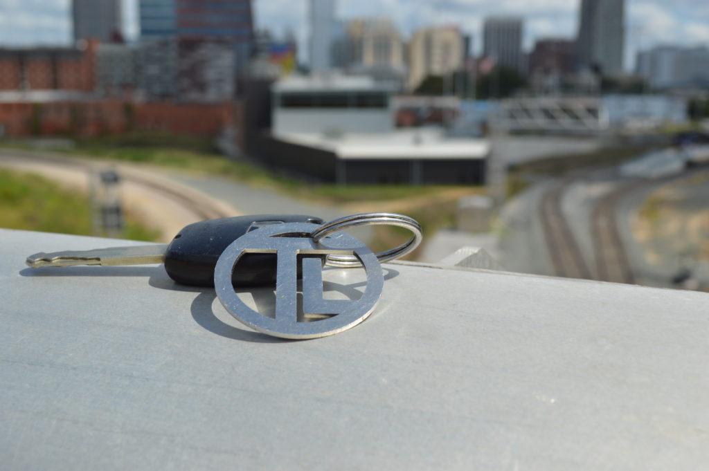 teddslist.com keychain bottle opener close up downtown Raleigh NC